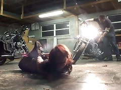 Biker girl hogtied in the garage tubes