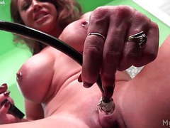 Brandimae pumps her big clit tubes