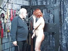 Mature redheaded slave with saggy tits is whipped in hippy's basement movies at kilovideos.com