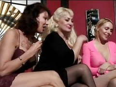 Mature women and two cute young friends have bald man worship their feet clip