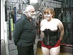 Young bdsm slave girl brunette in corset is spanked and caned in basement videos