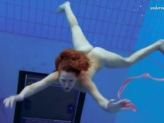 Curly hair redhead swims and looks sexy movies