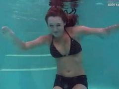 Redhead in cute bikini goes swimming videos