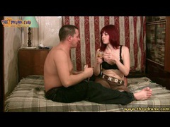 Redhead and her man share drinks movies