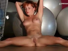 Redhead stretches naked in the gym movies at kilopills.com