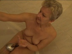 Shaved old pussy gets wet in the shower movies at freekilomovies.com