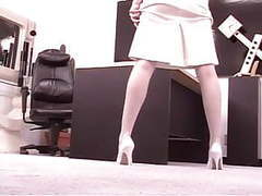 Sexy redhead office worker stretches her pussy with a dildo at her desk videos