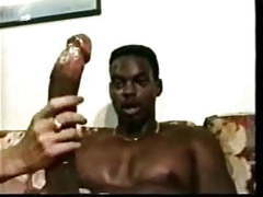 She calmly handles his massive black cock until it explodes videos