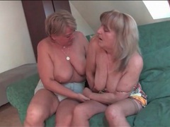 Mature lesbians kiss and suck tits on couch videos