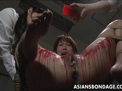 Asian babe get her privates covered in wax. videos
