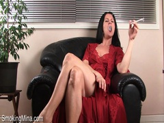 Milf in sexy satin nightgown smokes movies at kilosex.com