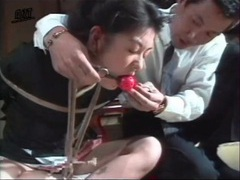 Gagged and bound girl drools in bdsm video videos