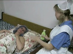 Cute nurse in lesbian foreplay with granny movies at freekilomovies.com
