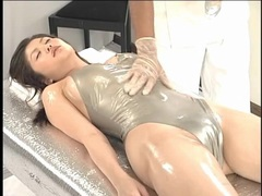 Shiny swimsuit on japanese girl getting a massage tubes at japanese.sgirls.net