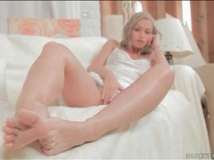 Beauty in soft white satin teases her feet videos