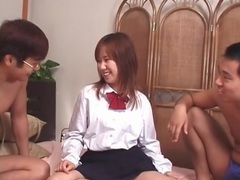 Japanese cutie in a skirt aroused by two guys movies at sgirls.net