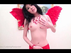 Ladyboy in corset and wings models her body movies at kilotop.com