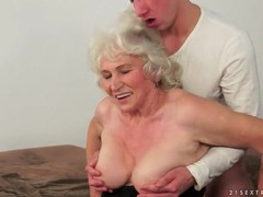 Kissing granny and sucking her sexy tits movies at freekilomovies.com