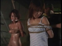 Two bound japanese girls suck on titties tubes at lingerie-mania.com