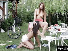 Cute lesbians get frisky in the garden movies at kilogirls.com