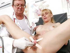 Slim mature woman's pussy check-up tubes