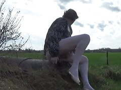 Crossdresser ts sissy in the countryside dildoing her ass in movies