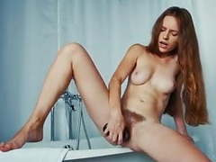 Sofi shane fucks her hairy hole with a dildo in the bathroom movies at kilogirls.com