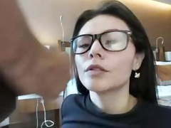 Girl in glasses takes a huge facial movies at freekilomovies.com
