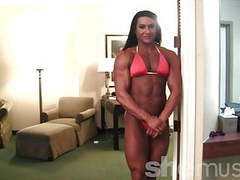Mature huge female bodybuilder with a mega ass poses videos