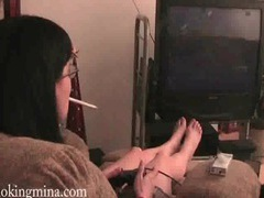Smoking girl plays video games tubes