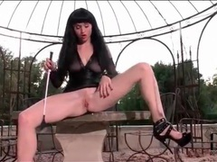 Brunette in black leather masturbates outdoors videos