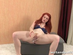 Redhead plays with toys in close up videos