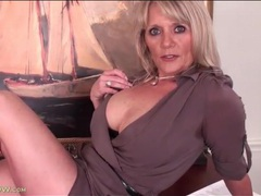 Seductive mature in a dress teases us videos