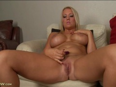 Curvy mom with fantastic implants masturbates movies at lingerie-mania.com