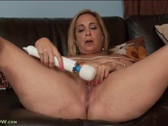 Chubby mature arouses pussy with a vibrator videos