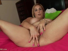 Chubby mature stuffs two fingers in her pussy videos
