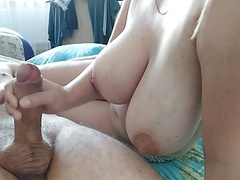 Her tits shake when she jerks off a cock,  videos
