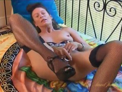 Dildo fucking milf chick in fishnet stockings videos