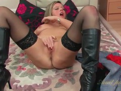 Black leather boots are sexy on solo milf tubes