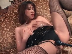 Asian subs in latex and fishnets enjoy toy play tubes at korean.sgirls.net