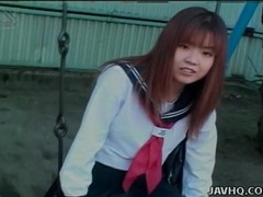 Schoolgirl upskirt on the swing set outdoors videos