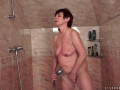 Mature gives a blowjob in the shower videos