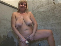 Curvy mature showers and fondles her big tits videos