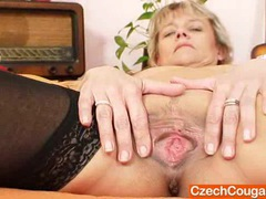Good-looking domina wife performs strange masturbation clip