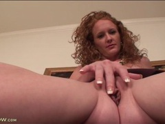 Sexy milf redhead masturbates pussy in close up videos