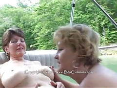 Busty mature lesbians on a boat,  movies