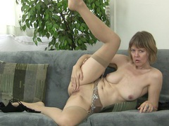 Old slut jamie foster takes off her clothes to masturbate on the sofa, Mature videos