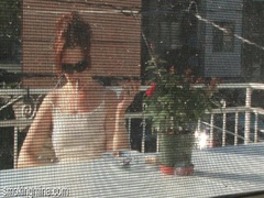 Cute chick smokes on the porch as he films it movies at lingerie-mania.com