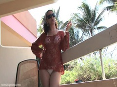 Bikini girl has a hot time smoking on the deck videos
