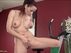 Sporty redhead strips off gym clothes and fingers movies at sgirls.net